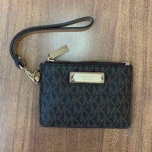 Michael kors coin purse wristlet with MK logo.